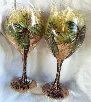 Back of bride and groom beach wedding glasses